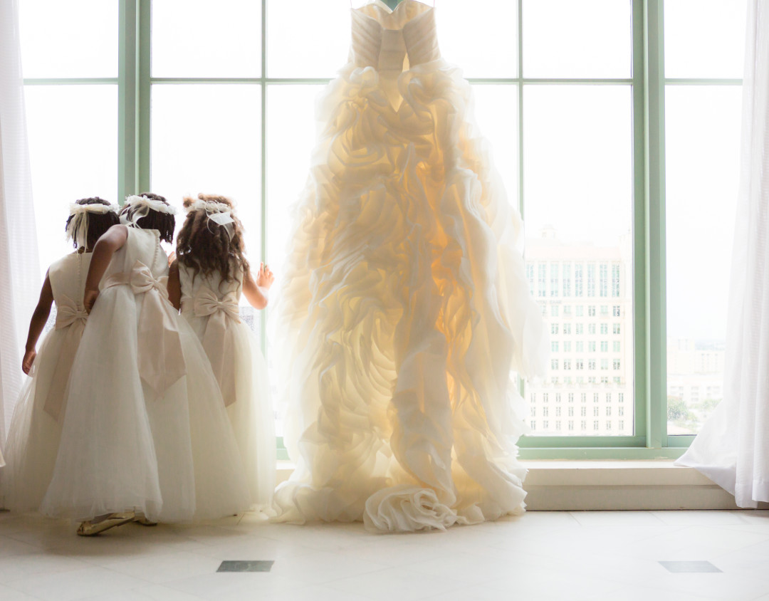Flower girls next to dress Photojournalism by Alfredo Valentine Couture Bridal Photography for Westin Colonnade Coral Gables Wedding