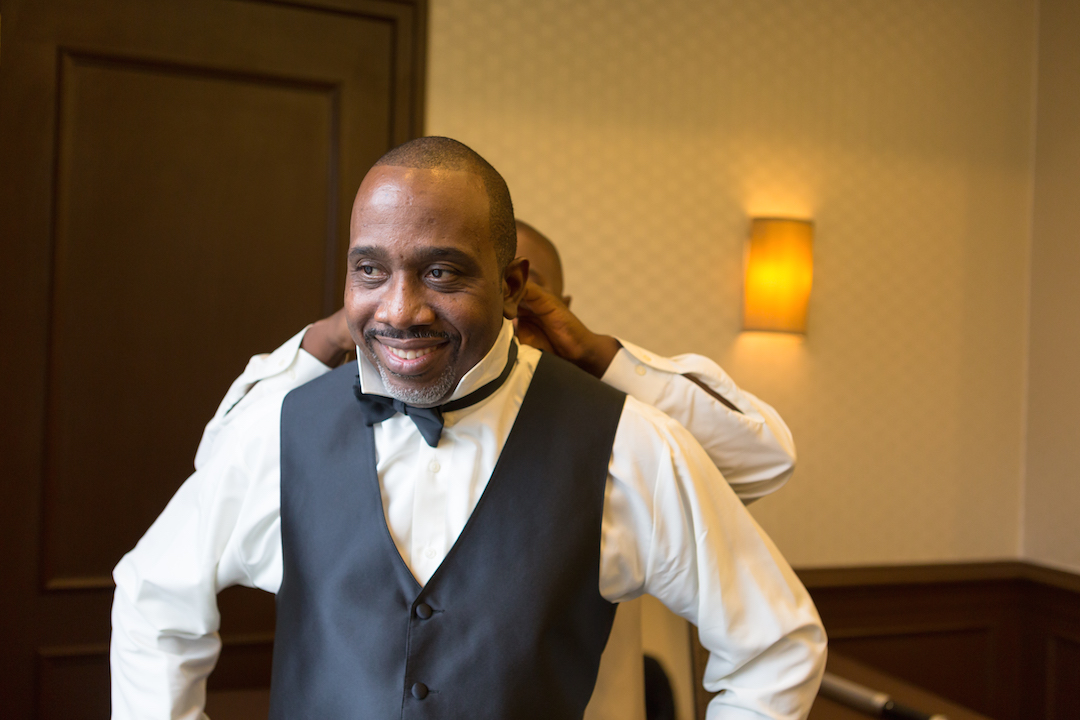 Groom getting ready for Westin Colonnade Coral Gables Wedding by Alfredo Valentine Couture Bridal Photography