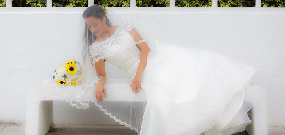 Couture Bridal Photography is a highly rated wedding photographer in Fort Lauderdale Florida serving south Florida and the caribbean. A bridal portrait of the the bride on a bench laying on her side during the cocktail hour at her Lakeside Terrace Wedding day Reception