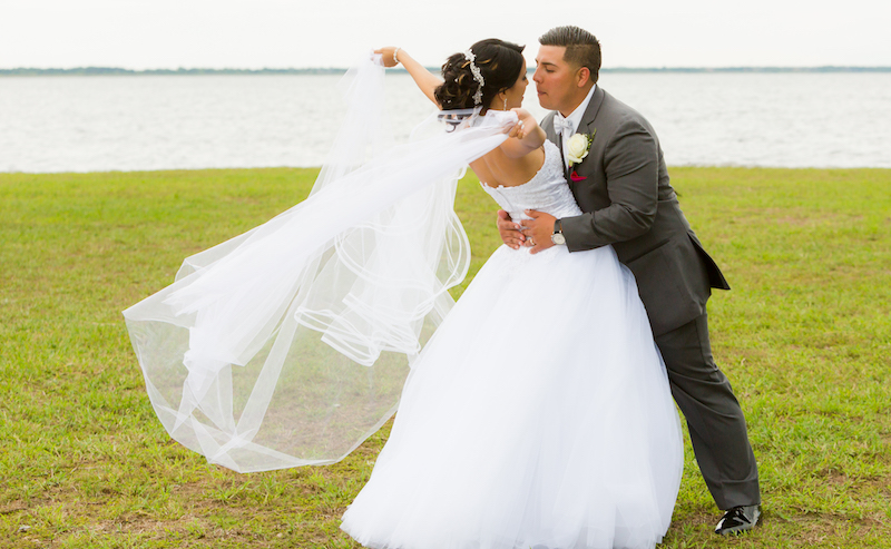 Couture Bridal Photography is an Orlando Wedding Photographer and captured this image of a bride and groom on the lake in an embrace