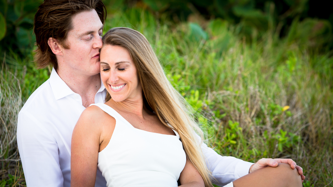 Fort Lauderdale Luxury Wedding Photography by Couture Bridal Photography bride and groom in a playful embrace.